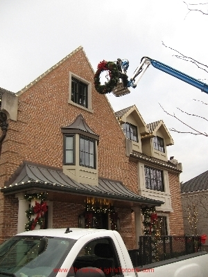 strathearn-in-toronto-at-work-hanging-wreath on genie lift by LawnSavers Professional Christmas Decorators