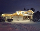 King City Home in Warm white with custom decorated wreath over garage