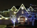 Thornhill Christmas Light Decorations by LawnSavers with Warm white LED minis, Garland, C9 LEDS on Fascia and multi colour minis on trees