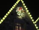 Christmas wreath secured on high peak by LawnSavers Christmas Decorators
