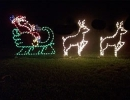 Wire frame santa-sleigh-with-2-reindeer-on-roof-top-yard-art