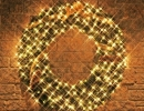 lit-Christmas-wreath-with-pinecones-gold-bow