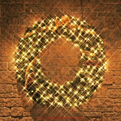 Led lights on Christmas-wreath-with-pinecones-gold-bow